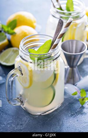 Spiked citrus lemonade in mason jars - Stock Photo