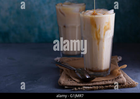 Iced coffee with milk in tall glasses - Stock Photo