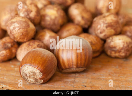 Hazelnuts on wooden table top - Stock Photo