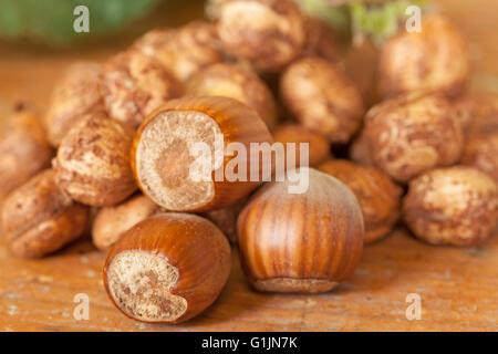 Hazelnut shells on wooden table top - Stock Photo