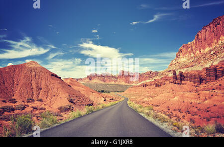 Vintage toned curved road, travel concept, USA. - Stock Photo