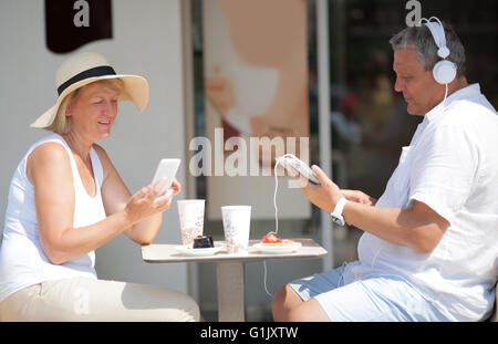 Middle-aged couple relaxing on summer vacation - Stock Photo