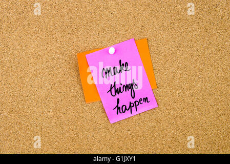 Make Things Happen written on paper note pinned on cork board with white thumbtack, copy space available - Stock Photo