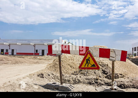 Work in progress, triangle sign with boundary are symbols of caution, road resurfacing signal. - Stock Photo
