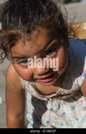 Little girl with messy face, Feria de Mataderos, Buenos Aires, Argentina - Stock Photo