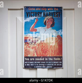 You are needed in the fields  Victory Harvest poster recruiting land girls on doorway in the village of Haworth, - Stock Photo