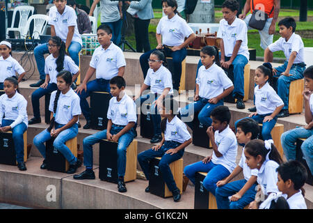 School percussion band waiting to perform in a Lima park - Stock Photo