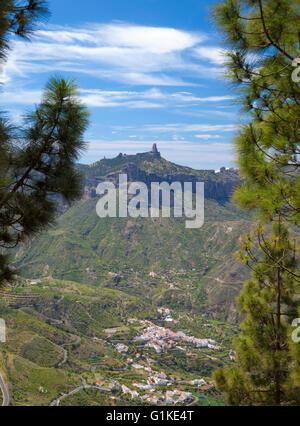 Gran Canaria, view towards Roque Nublo and Tejeda village through Pine Trees - Stock Photo