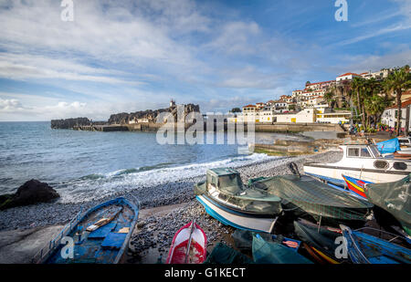 Old colorful fishing boats laying on the shore in Camara de Lobos - Stock Photo