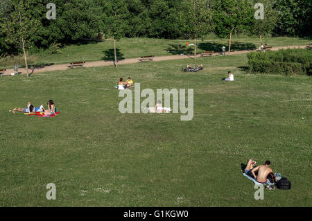 People sunbathing in park along Rio Tormes, Salamanca, Spain - Stock Photo