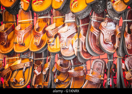 Leather craft stalls in a medieval fair - Stock Photo