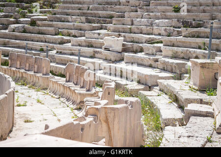 Marble thrones in the Theatre of Dionysus. Athens, Central Athens. Greece - Stock Photo