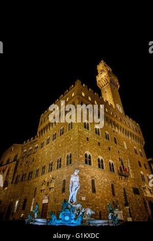night view illuminated statue of Neptune Palazzo Vecchio Piazza della Signoria Florence Italy - Stock Photo
