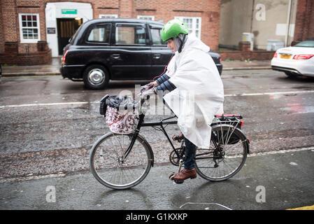 Woman Riding Bicycle In Rain Hanoi Vietnam Stock Photo Royalty