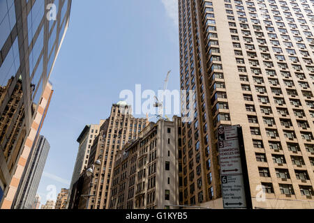NEW YORK, USA - APRIL 21, 2016: Skyscrapers in New York, USA. With more tha 8 million citizens it  is the most populous - Stock Photo