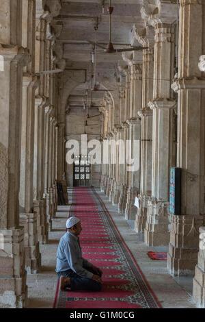 Man Praying, Sarkhej Roza, Ahmedabad - Stock Photo