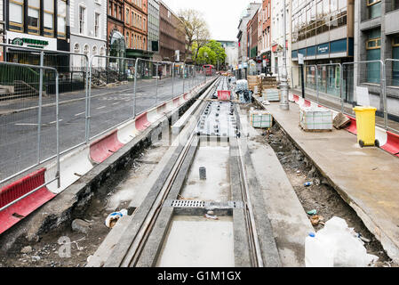 Construction of a tram line along a Dawson Street in Dublin. - Stock Photo
