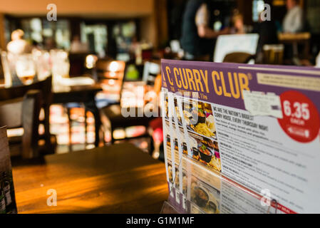 Curry Club menu on a table in a Wetherspoon's pub/restaurant, available every Thursday. - Stock Photo