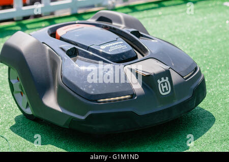 Husqvarna automower robotic automated lawn grass mower. - Stock Photo