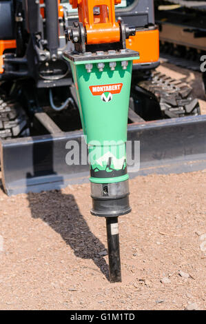 Montabert hydraulic hammer drill heavy breaker attached to a tracked digger. - Stock Photo