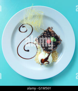 tasty double chocolate brownie with ice-cream plating - Stock Photo