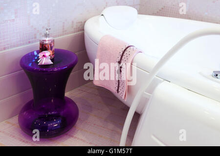 beautiful big bath in the pink bathroom - Stock Photo