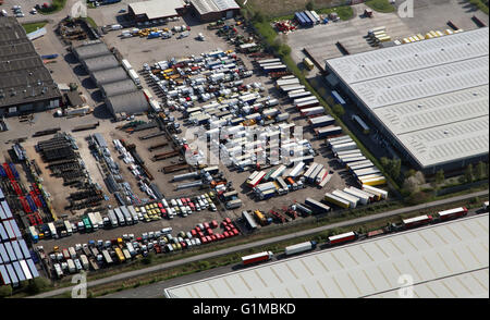 aerial view of a compound yard full of old trucks and vehicles - Stock Photo