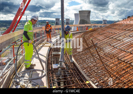Concrete pour on new cooling tower - Stock Photo
