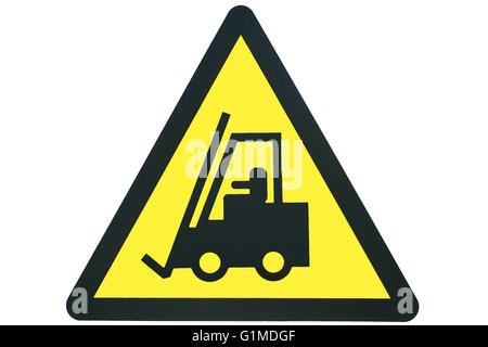 A triangular warning sign showing a forklift shape in black, against a yellow background inside a black triangular - Stock Photo