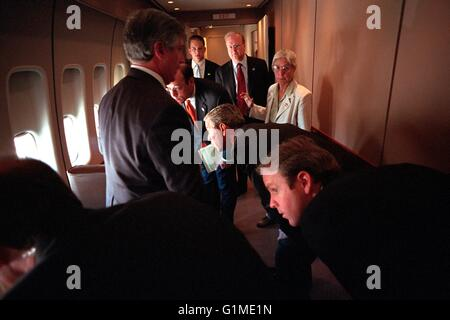 U.S President George W. Bush and his staff look out the windows of Air Force One at their F-16 escort following - Stock Photo