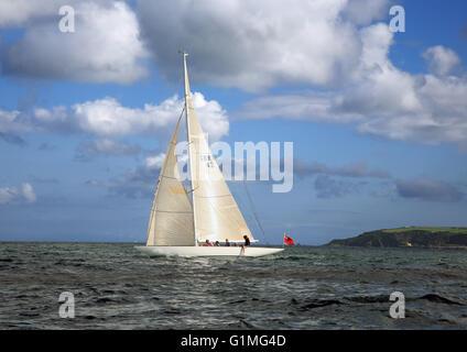 Classic International Six-Metre 'Melita', beating on port tack across Falmouth Bay off the Helford River, Cornwall, - Stock Photo