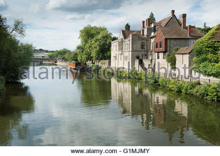 View along the River Medway at Maidstone to the opposite bank showing reflections in the water - Stock Photo