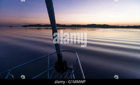 View towards Musket Cove at dawn from the anchorage near the island resort. Fiji - Stock Photo