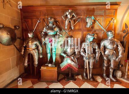 Medieval suits of armour on display, Warwick castle interior, Warwick, Warwickshire England UK - Stock Photo