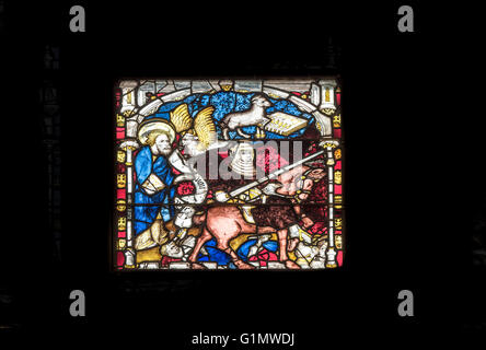 One of the117 story panels in the medieval stained glass window at the east end of York Minster (cathedral), England. - Stock Photo
