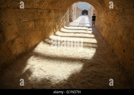 Undercroft of roman biggest amphitheater in africa in El Djam, Tunisia - Stock Photo