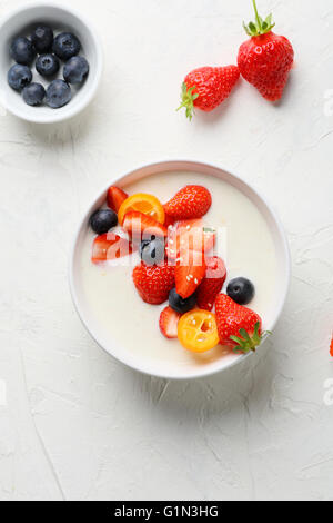cereals with yogurt and berry in bowl - Stock Photo