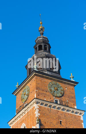 Krakow Town Hall, detail of the top of the Town Hall Tower in the Market Square (Rynek Glowny), Krakow, Poland. - Stock Photo