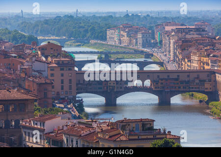 Florence, Florence Province, Tuscany, Italy.  View from Piazzale Michelangelo to bridges across Arno river. - Stock Photo
