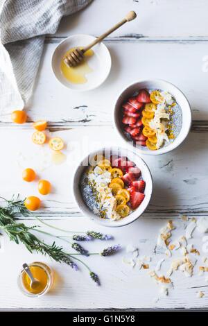 chia pudding breakfast bowls with kumquats, berries & lavender honey. Gluten-free, dairy-free. - Stock Photo