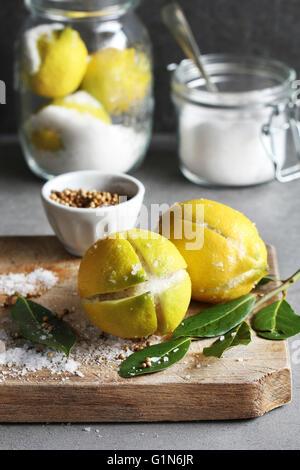 Preparing preserved lemons - Stock Photo