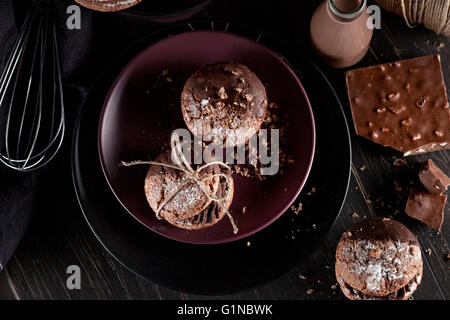 Italian maroni cookies on the plate and chocolate milkshakes, cloth, notebook on dark old wooden background - Stock Photo