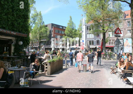 Cafés and people on terraces at Gerard Douplein square, De Pijp area, Amsterdam Oud Zuid, Netherlands. Spring 2016 - Stock Photo