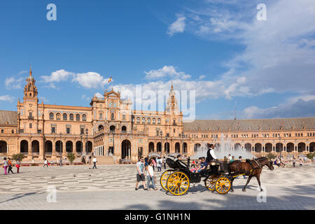 UNESCO world heritage site Plaza de Espana, Seville, Spain. A horse drawn carriage and tourists in the foreground. - Stock Photo