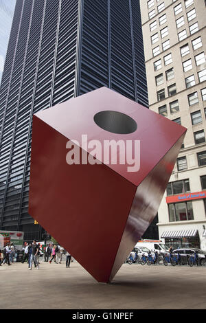 Isamu Noguchi's 28-foot tall piece of public art Red Cube  in the plaza by HSBC at 140 Broadway in the Financial - Stock Photo