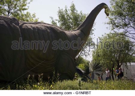 The citizens visit the giant simulation dinosaurs at the Dongfeng dinosaur park which like a Jurassic park in Beijing,China - Stock Photo