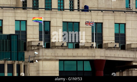 London, UK. 17th May, 2016. The Rainbow Flag flies alongside the Union Flag outside the MI6 headquarters in Vauxhall, - Stock Photo