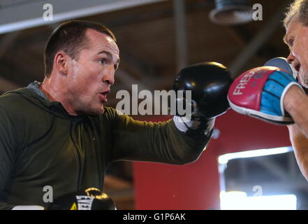 Russian boxer, WBA cruiserweight champion Denis Lebedev (R) and his coach Freddie Roach training ahead of the upcoming - Stock Photo