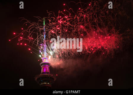New Year's Eve fireworks from the top of the Sky Tower at midnight to welcome in 2016, Auckland, New Zealand - Stock Photo