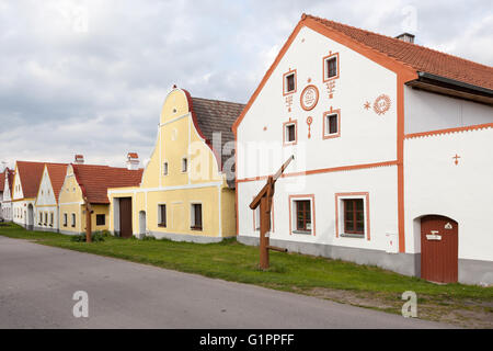 Facades of houses at historical village of Holasovice - Stock Photo